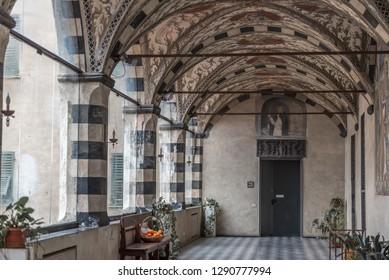 Genova, Genoa, Italy - January 2019: Loggia corridor of the Annunciation (Loggia dell'annunciazione), Santa Maria di Castello church, Dominican complex nearby Tower of Embriaci, Torre degli Embriaci