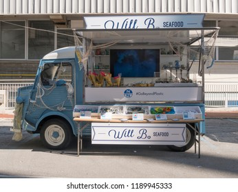 Genova, Italy - 09/21/2018 - Awareness campaign against plastic waste in the sea - Fake pickup truck for street food with dishes made from plastic waste.