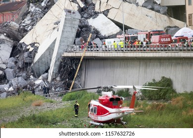 Genova, Italy - August 14 2018  A large section of the Morandi highway bridge collapsed in Genoa, leaving vehicles crushed in rubble below. Rescuers work to recover injured persons.