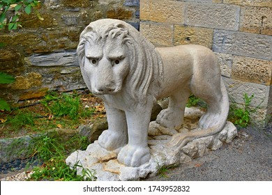 GENOVA, ITALY - August 23, 2019: Lion statue in front of the Castello d'Albertis museum building, museum of art and world cultures
