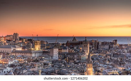 Genova, Italy: Beautiful sunset aerial panoramic view of Genoa historic centre old town (San Lorenzo Cathedral, duomo, Palazzo Ducale), sea and port at dusk. Romantic cityscape Europe at night