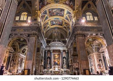 Genova, Genova, Italy - January 2019: Sumptuous marble interior with frescoed ceilings of baroque church Chiesa dei Santi Ambrogio e Andrea known as Chiesa del Gesù, Piazza Matteotti