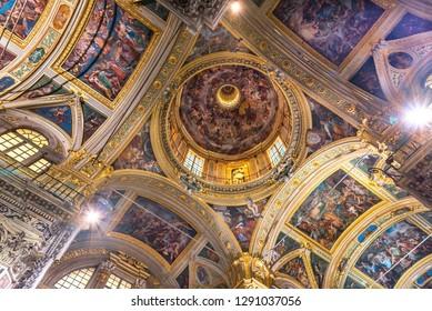Genova, Genova, Italy - January 2019: Sumptuous frescoed ceilings and dome of baroque church Chiesa dei Santi Ambrogio e Andrea also known as Chiesa del Gesù, Piazza Matteotti nearby Palazzo Ducale