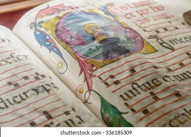 Genova, Italy - July 2015 - Medieval ancient illustrated illuminated monastic manuscript with sheet music Gregorian chant, illustrative editorial, artistic selective focus