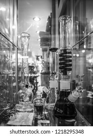 GENOVA,ITALY-12 OCTOBER,2018: Ganja shop sell legalized marijuana, glass bong pipes and accessories for smoking weed.Legal light drug store in close up