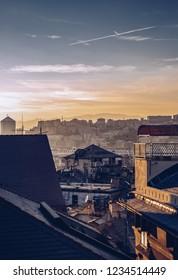 GENOVA,ITALY-12 OCTOBER,2018: Old city of Genoa at sunset. Vertical cityscape view at dusk.Popular travel destination for cultural tourism.Instagram vintage film filter