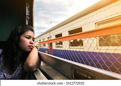 Genre portrait of lonely woman in train. feel homesick