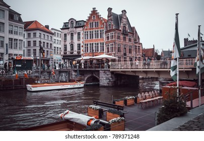 GENT, BELGIUM - January 2, 2018: City center of Gent, with canal, bridges,cafe's and unique buildings.