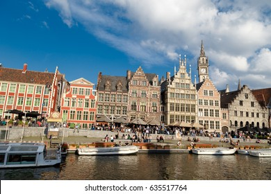GENT, BELGIUM - JULY 6, 2016 : View of Graslei and Korenlei between medieval architecture buildings with tourist boats in Gent canal. Gent is popular place in Belgium.