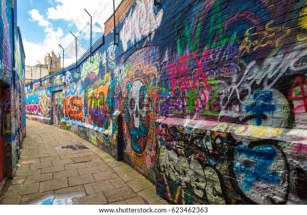GENT, BELGIUM - JUNE 14, 2016: Graffiti street in Gent in a beautiful summer day, Belgium on June 14, 2016