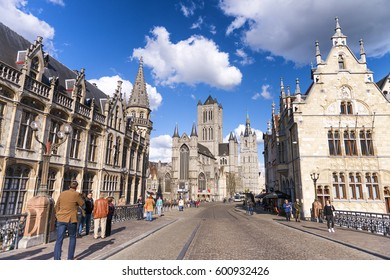 GENT, BELGIUM - MARCH 2015: Tourists visit ancient medieval city. Gent attracts more than 1 million people annually.
