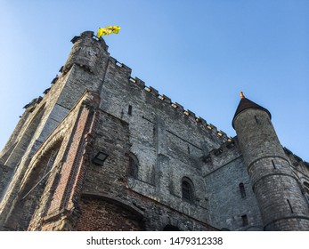 Gent, Belgium - September 30th 2017 : Low angle view  of one part the medieval castle the Gravensteen (Castle of The Counts) in Gent, with the flag of flanders on the top of one of the tower
