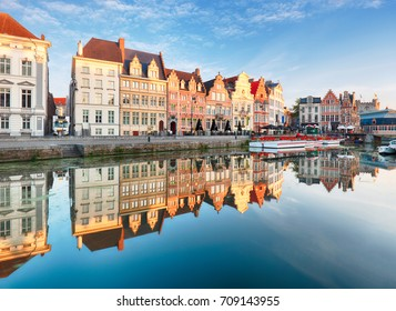 Gent, Belgium. Sunrise in historical center of Ghent reflecting in water of river Leie Flanders, Belgium.