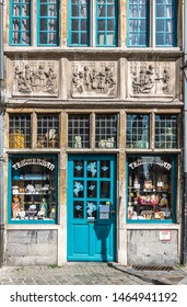 Gent, Flanders, Belgium -  June 21, 2019: Historic small shop on Kraanlei houses Confectioner Temmerman. authentic candy of a previous era. Three of Matthew Works of Mercy sculptures in facade.
