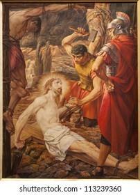 GENT - JUNE 23: Jesus Christ Crucified. Paint in st. Peter s church by Josef Piens Cooreman on June 23, 2012 in Gent, Belgium.