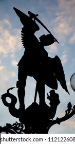 Gent - silhouette of statue of st. Michael from bridge