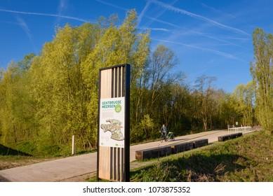 GENTBRUGGE, BELGIUM. April 19, 2018. Park entrance to nature reserve called Gentbrugse Meersen with wetlands and shallow marsh. Located on large meander in river Schelde near Ghent. Flanders, Belgium.