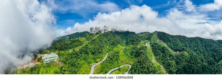 Genting Highland, Malaysia - December 11, 2019: Aerial panoramic view of Genting Highland Resort during bright cloudy day. Genting Highland is a famous landmark featuring its world class theme park.