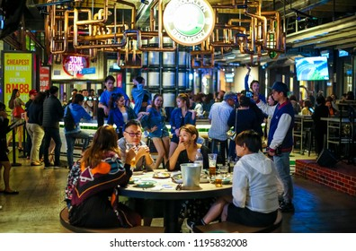 GENTING HIGHLAND, MALAYSIA - OCTOBER 05, 2018: People enjoy chill out  dining at bar restaurant. Food and drinks casual dining hangout.