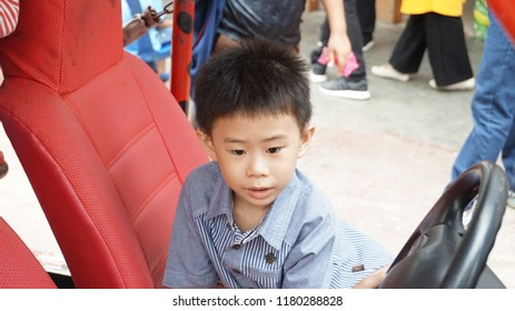 Genting Highland Strawberry Park / Malaysia - September 9 2018: Kids playing in amusement park car
