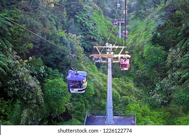 GENTING HIGHLANDS, MALAYSIA - 16 DECEMBER 2018 : Tourists travel on cable car of Genting Skyway. It is a gondola lift connecting Gohtong Jaya and Genting Highland.
