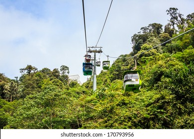 GENTING HIGHLANDS, MALAYSIA - DECEMBER 21 : Tourists travel on cable car of Genting Skyway on Dec 21,13 in Malaysia. It is a gondola lift connecting Gohtong Jaya and Resorts World Genting.