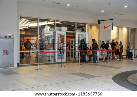 44c0d5b20 GENTING PREMIUM OUTLETS, MALAYSIA - SEPTEMBER 2018: In front Nike Outlet.  Nike is
