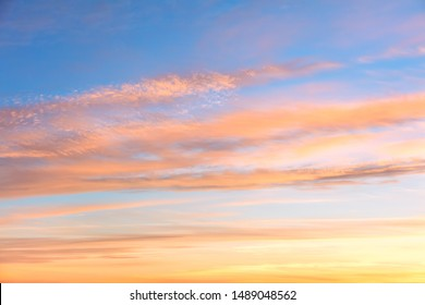 Gentle colors of Sunrise sundown sky with  soft clouds background