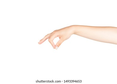 A gentle female hand is holding something with her right hand on isolated white background.