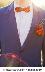 Gentle groom boutonniere with ranunculus