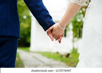Gentle hand of the bride in the man's hand