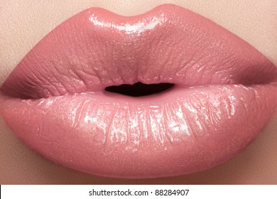 Gentle kiss. Beautiful fashion lip make-up. Macro of female lips with natural light makeup
