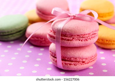 Gentle macaroons on table close-up