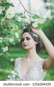 gentle portrait of a beautiful bride in a spring park