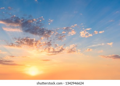 Gentle Sky at Sunset or Sunrise time with real sun and clouds, natural colors, big size panoramic background