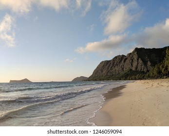 Gentle wave lap on Waimanalo Beach looking towards Rabbit island and Rock island on a nice day Oahu, Hawaii.  June 2018.
