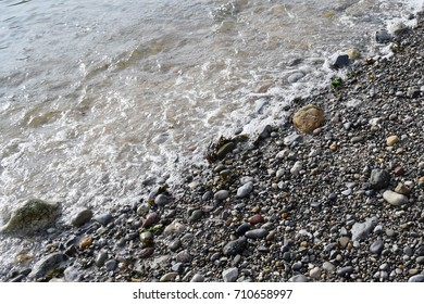 Gentle waves rolling onto a pebble beach