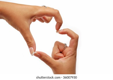 Gentle woman hands in the shape of a heart