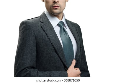 gentleman in a gray suit and tie