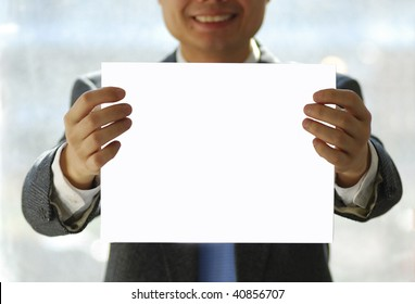 Gentleman holding an isolated white paper.  Your text is on the paper.