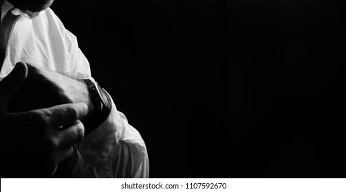 gentleman on a dark background