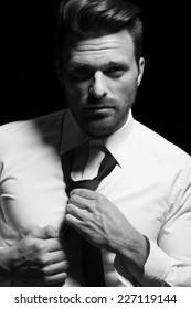 Gentleman with tie in white shirt