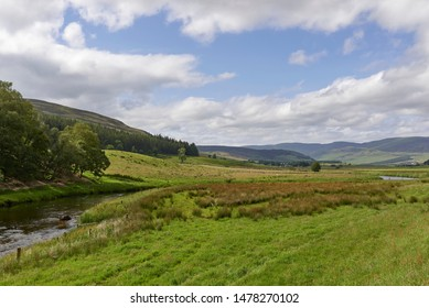 A gently flowing river wends its way across the Valley floor of Glen Clova in the Angus Glens of Scotland, on a perfect Autumn afternoon.