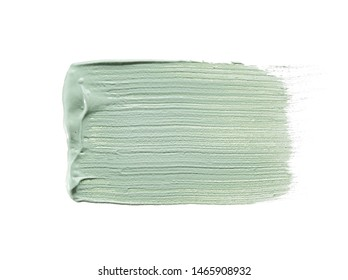 Gently green strokes and texture of face cream or acrylic paint isolated on white background