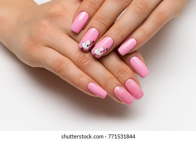 gently pink manicure with sparkles with painted hearts and arrows on square long nails