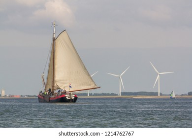 A genuine authentic Dutch sailing vessel sailing in the nature reserve the Oosterschelde in the Netherlands