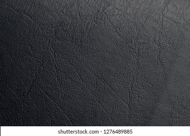 Genuine black leather texture abstarct detail beautiful rough close up.
