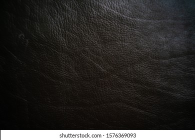 Genuine black vegetable tanned leather crafts background, Cowhide leather