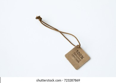 Genuine brown leather label on white background