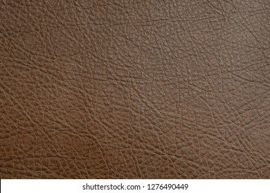 Genuine brown leather texture abstarct detail beautiful rough close up.